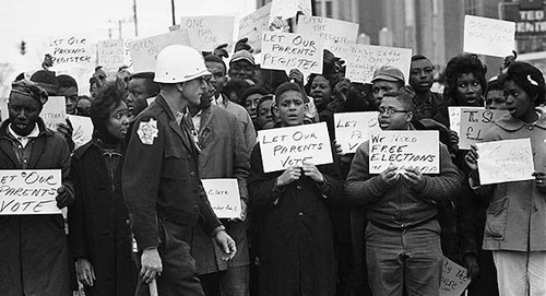 Black voters protesting literacy tests